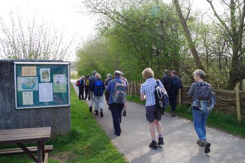 Members walking past noticeboard at the reserve