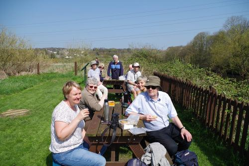 Members sitting at picnic tables eating lunch at Rodley reserve
